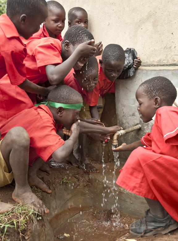 Muguluka Primary School children enjoying the water